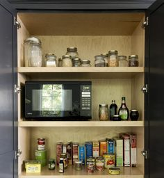 The microwave oven lives in the pantry. A top priority when designing the kitchen was to hide the microwave.