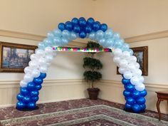 Groupings of color latex balloon arch