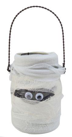 Boo!  A little gauze, black trash bag and craft eye makes an adorable Halloween jar.