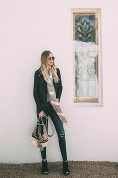Dash of Darling shares a spring outfit wearing ripped denim with a bodysuit and pink stripe scarf and knit bag.