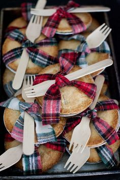 Fall mini pies tied up with plaid flannel and wooden forks