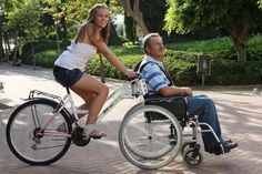 Truly a bicycle built for Imagine a beautiful bike ride with a loved one through a park like this. Looks like fun! A wheelchair bike is beautiful engineering. Velo Tricycle, Adult Tricycle, Velo Cargo, Wheelchair Accessories, Mobility Aids, Bike Design, Tandem, Cool Bikes, Upcycle