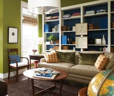 Colour creates a cozy, welcoming look in this reading space. Back of bookshelves colour, Hello Darkness (P1792-3) Para Paints; wall colour, Green Court (P959-7), Para Paints.  Designer: Suzanne Dimma.