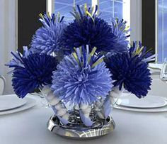 Centerpieces most often are designed around flowers, and there are some stunning blue flowers available in the summertime. Summer is a beaut...