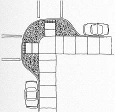 Figure 7-35. Curb extensions extend corners into parking lanes and provide space for curb ramps.