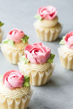 These lemon cupcakes are filled with passion fruit curd and frosted with beautiful buttercream flowers.  The lemon cupcake recipe is easy and moist.  The passion fruit curd bursts with flavor.  The perfect treat for any spring celebration! #eastercupcakes