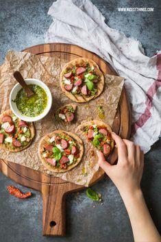 Grilled Mini Pizza with Salsa Verde, Kabanossi, Dried Tomatoes, Mozzarella