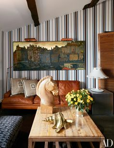 On the vintage Gio Ponti cocktail table is a Rafael Garcia horse-head sculpture and a Gabriella Crespi shell.