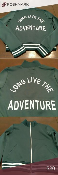 Long Live the Adventure Jacket Long Live the Adventure Jacket. It's more green-turquoise than blue-turquoise. The pics of the Jacket laying on my table are more true to color than the pics modeling it. Lighting is everything... Jackets & Coats