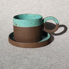 Turquoise glazed Brown clay is completely shaped by handmade coffee cups without mold and is painted by doppiocotto. The plate method, which is one of the ceramic forming methods, is combined with the body, the base and the handle, and the plate-shaped side walls and the base are combined and the form you see is reached.   Therefore, each ceramic cup prepared may differ from one another in terms of color texture and shape. Modern Ceramics, Contemporary Ceramics, Best Coffee Mugs, Coffee Cups, Throwing Clay, Ceramic Cups, Cup And Saucer, Terracotta, Gifts For Him