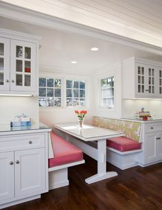 Mix prints on the seats and booth backs. The combination snazzes up the booth in this white kitchen, making it inviting.