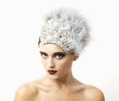 Crystal Protection   Alexandra Harper   Autumn/Winter 2013, Coleoptera Collection   Materials: grey tulle, matte silver metal beads, grey acrylic beads and Swarovski rhinestones. Fully lined   Vintage-inspired silvery-grey headpiece with hand-beaded plaque of acrylic beads, metallic beads and Swarovski rhinestones fringed by a delicate tuft of grey tulle   Underside skull cap secures piece to head with clear comb and double elastic. Can be worn on either side of head. One size fits all