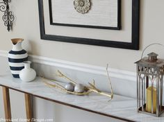 I'm excited to share a new tutorial with you today! I have been eyeing this cute, sleek, and chic console table over at Wisteria.     via Wisteria Did I mention it is topped with marble??  Ooh la la!  I was thinking that it  would sure look good in my dining room under the framed art.  There is just enough space behind the table that it seems to need something there but a certain something that would not take up too much space width wise, like Wisteria's console table!     However…