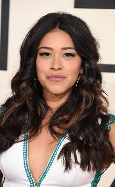 The best cuts, products and styling tips for thick, wavy hair like Gina Rodriguez's gorgeous locks.
