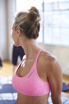Practice something positive with Reebok's pink printed sports bra. It's perfect for your next yoga class.