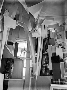 1933, Merzbau by Kurt Schwitters dada/constructivism. Considered merzbau a principle. In completed work that continued to grow & change