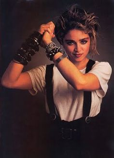 Madonna, 1982 - Those bangles she is wearing, yup I had it all going on. Lace tights, white gloves, tube skirts and really black eyeliner.