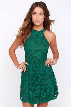 From birthday parties to dinner for two, you're going to find any chance you can to wear the In Full Plume Green Lace Dress! A halter neckline tops the fitted sleeveless bodice of this cocktail dress, with plenty of patterns dancing in the green lace. Fitted waist introduces a flared skirt, over a darker green stretch knit lining. Hidden back zipper. Fully lined. Self: 90% Nylon, 10% Spandex. Lining: 100% Polyester. Hand Wash Cold.