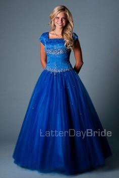 The Mabrey   A classic princess gown. This full tulle skirt is accented with beading at the waist and a satin corsetted bodice. A beautiful modest prom dress.    Dress available in Red or Blue    Available at LatterDayBride.com or in Store At Latter Day Bride Located in Salt Lake City, Utah