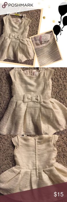 Formal dress 👗 for 2 year old (NEW!) Cream dress with a bow by the waist! Has gold and silver horizontal lines throughout dress which has a shimmer adding that glamorize look for any party! New and never worn as my daughter out grew before she could wear. Our loss is your gain! From pet free and non-smoking 🏡. Thanks! Dresses