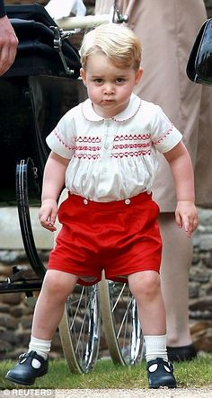 Prince George wore the £85 Rachel Riley outfit of red shorts and a smocked top for his sister Charlotte's christening in Sandringham earlier this month. It is strikingly similar to the ensemble worn by his father William in September 1984, when the two-year-old met his day-old brother Harry for the first time