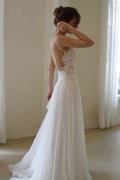 I like the beads draped on the back and the lace. Very flowy, more simple.