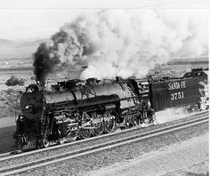 Steam train, locomotive, steam, smoke, on rails, history, railway, railroad, transportation, photograph, photo b/w.