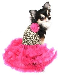 Gorgeous! This dress is a one-of-a-kind creation. On trend brown leopard print in cotton on top with a hot pink tulle flower accent; bottom is ruffles of hot pink tulle. Cut generously underneath to all for Nature's call.