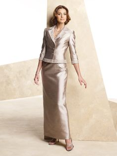 Two-piece silk shantung suit, strapless sheath features neckline trimmed with beading and center back slit, matching jacket with heavily beaded notched collar and cuffed three-quarter length sleeve. Removable straps included. Sizes:4 – 20, 4P – 14P