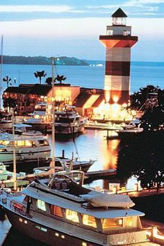 The Harbour Town Lighthouse in Hilton Head, South Carolina was built as a private aid to navigation in Photo courtesy Hilton Head Visitors & Convention Bureau. by esperanza Places To See, Places To Travel, Places Ive Been, Harbor Town, Beacon Of Light, Light Of The World, Hilton Head Island, Vacation Spots, East Coast