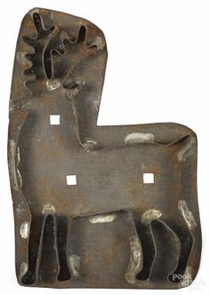 Winning bid:$475  Tin sheet iron stag cookie cutter, 19th c., 8 1/4'' h. Provenance: Richard and Rosemarie Machmer Collection, Conestoga Auction, November 2001, Lot 562.- Price Estimate: $300 - $500