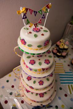 homemade wedding cake, bunting and flowers