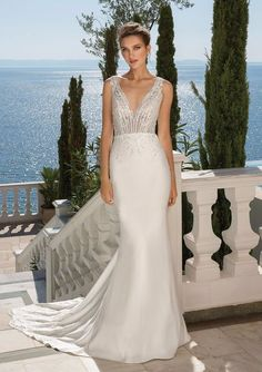 Timeless and elegant. Light beading and Venice lace adorn the deep V-neckline. Finished with a chapel length train. This is all you'll want for your big day.