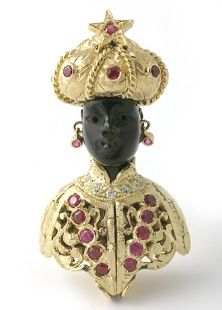 """At first sight, this piece looks like another beautiful Moretto brooch by Nardi. The emblem of the city of Venice, inspired by Shakespeare's Othello. A jet carved head adorned with golden turban and dress set in rubies and diamonds. But this one is an """"Aprible"""" moretto!, the dress opens up to reveal an image of the city of Venice!, a nice touch to make the jewel more interesting and secretively special."""