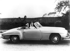 Grace Kelly owned a Mercedes Benz 190 SL, pictured here with Frank Sinatra