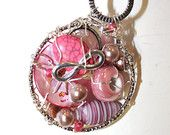 Pink MUSKOKA STONE wire wrapped pendant is made with stirling silver wire, glass and resin beads and pewter pieces.