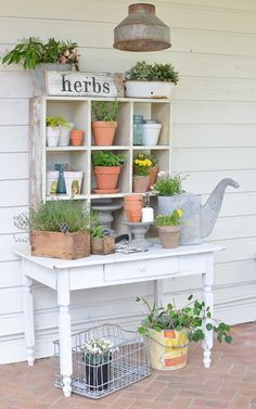 My Shed Plans - This farmhouse style potting bench is full of vintage charm and perfect for summer. Complete with a chippy white table and vintage cubby. - Now You Can Build ANY Shed In A Weekend Even If You've Zero Woodworking Experience! Outdoor Potting Bench, Potting Tables, Farmhouse Potting Benches, Potting Bench With Sink, Greenhouse Benches, Outdoor Benches, Outdoor Patios, Dining Tables, Outdoor Storage