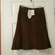 Pretty NWT CABI  Suede Chocolate brown skirt New W/tags Choc Brown real suede Bottom of the A-line has a ruffle type detail  Zipper close Beautiful ! Never worn Cabi Skirts A-Line or Full