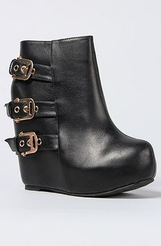 The Camilla Buckle Wedged Bootie in Black-- omg I need this in my life like now.