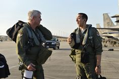 Son flies in father's footsteps. Col. Al Wimmer, Air Forces Northern's Director of Operations and Information Operations exchanges a word with his son, Capt. Taylor Wight, before their dissimilar aircraft mission Dec. 12. Wimmer is an F-16 Viper pilot while his son, Wight, is an F-15 Strike Eagle pilot.(Photo by Master Sgt. Kurt Skoglund)