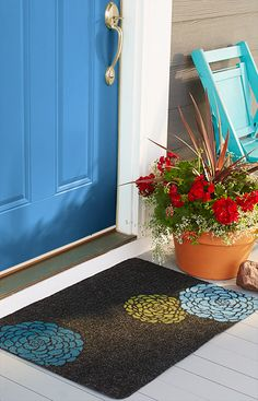 Paint an inexpensive welcome mat to complement your home's exterior, or vary the theme by season.