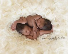 A Peek in the Womb Amazing photo of gorgeous African American twin newborn boy