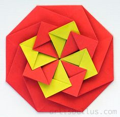 Origami Tato ... luv the bright red and yellow geometric shapes ... Marcela says that a tato is a traditional Japanese purse used to store flat items ... can also be used as an envelope ... great way to send invitations ...