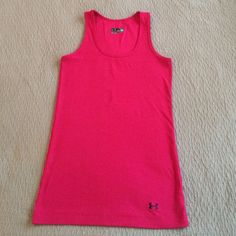 Under Armour Tank Pink ribbed tank, stretchy fast drying fabric. Size medium. Worn a couple of times but in excellent condition. Under Armour Tops Tank Tops