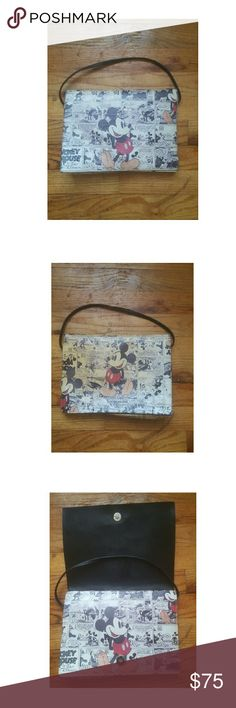 Vintage Mickey Mouse Newpaper Bag (Exclusive) -Vintage news paper bag -The newspaper is still aging causing the bag to become more unique.  -Perfect exterior and interior  -Can be carried by short handle or like a clutch -Great for the ladies who want to add a little personality to their wardrobe -Fast shipping: same day or next day depending when purchased. Bags Clutches & Wristlets