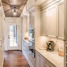 @joannabgoodman created a great working space behind the main kitchen with lots of great storage and double ovens.  Love the French door at the end.  #interiordesign #renovation #kitchen