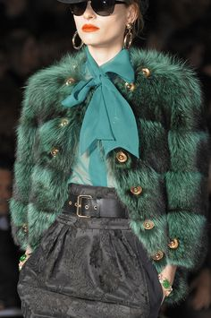 Fake fur, large gold buttons, fitted