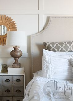 Check out the tutorial for this nail head-trimmed, upholstered headboard created by ThriftyandChic.com for under $40!