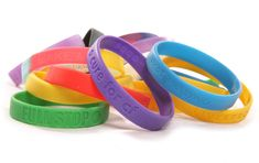 Photo about Various charity wristbands cutout taken in a studio. Image of wristbands, giving, space - 9738756 Rubber Bracelets, Silicone Bracelets, Recycling Information, Metal Straws, Good Grips, How To Raise Money, Reuse, Charity