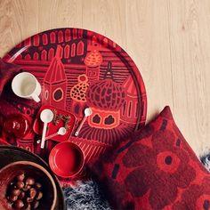 Marimekko's Pieni Unikko cushion cover and Kumiseva tray in red